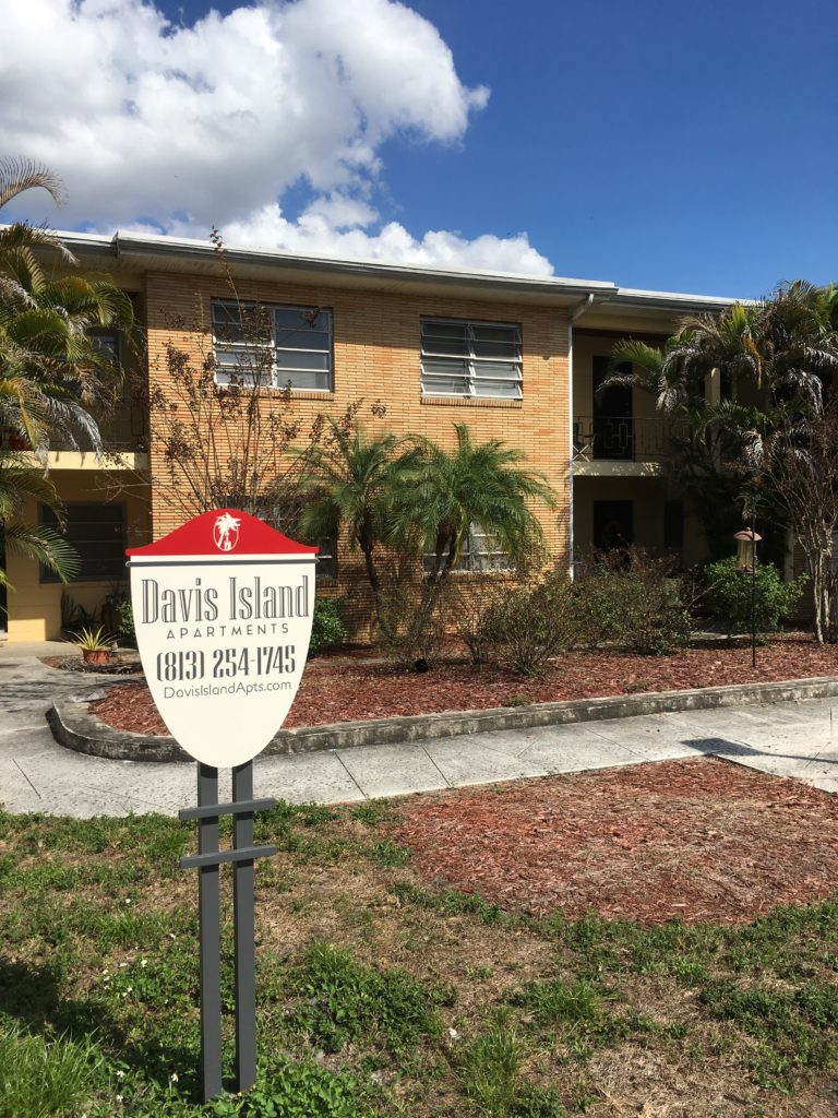 Image of Davis Island Apartments building and sign. Phone number: 813-254-1745.